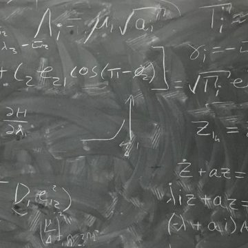 chalkboard with astrophysics equations